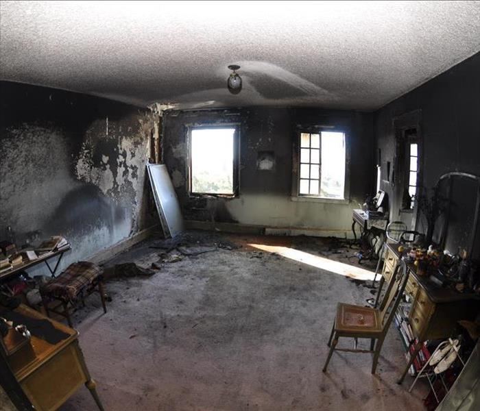 The bedroom fire was caused from a match thrown into a trash can ! Before