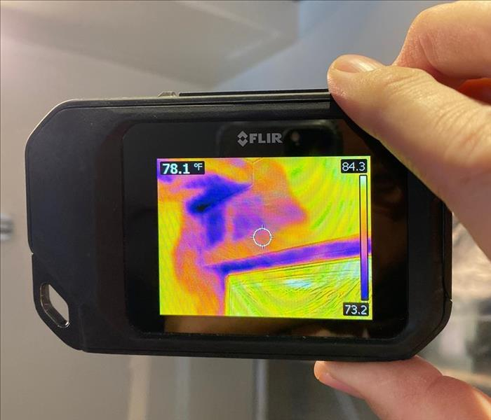 using an infrared camera to help see a wet wall and ceiling in a home that has fresh water damage